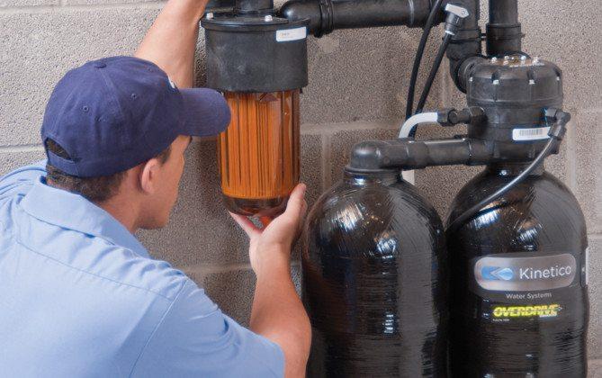 Service Technician Inspecting Softener LR