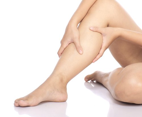 person holding their leg